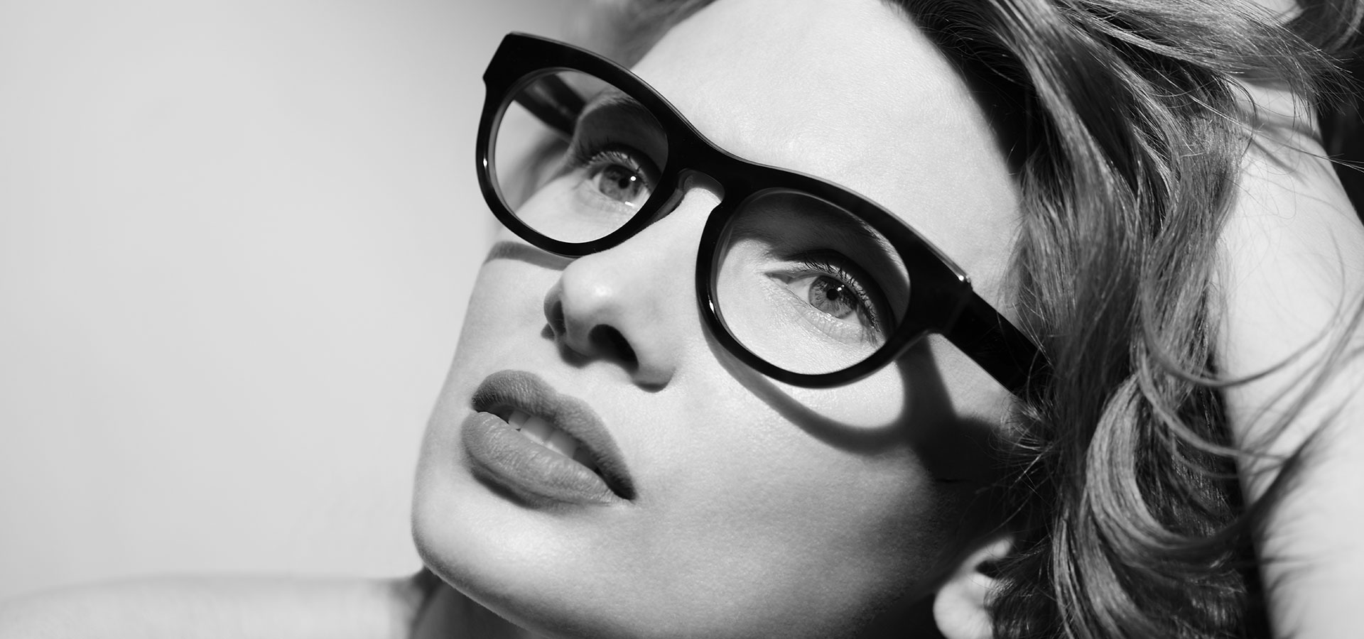 Female model wearing acetate optical frame TD601 from the Tom Davies 2020 Collection